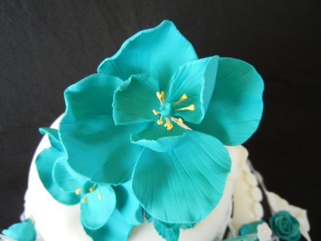 close up teal gum paste flower