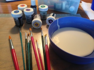 supplies to paint with royal icing cake
