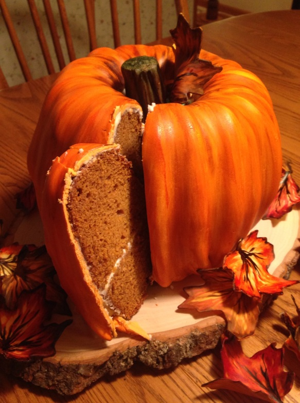 pumpkin cake being cut open fondant