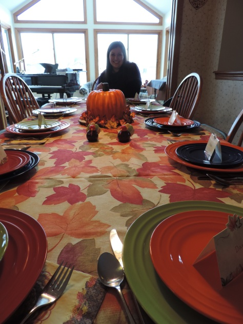 thanksgiving table with pumpkin cake centerpiece
