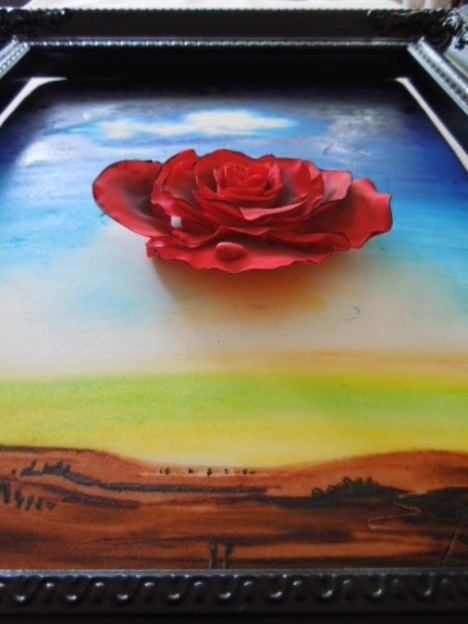meditative rose painting on a cake with gum paste rose