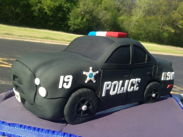 police car cake in parking lot