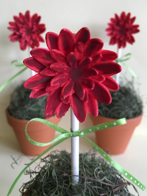 red flowers on cake pops